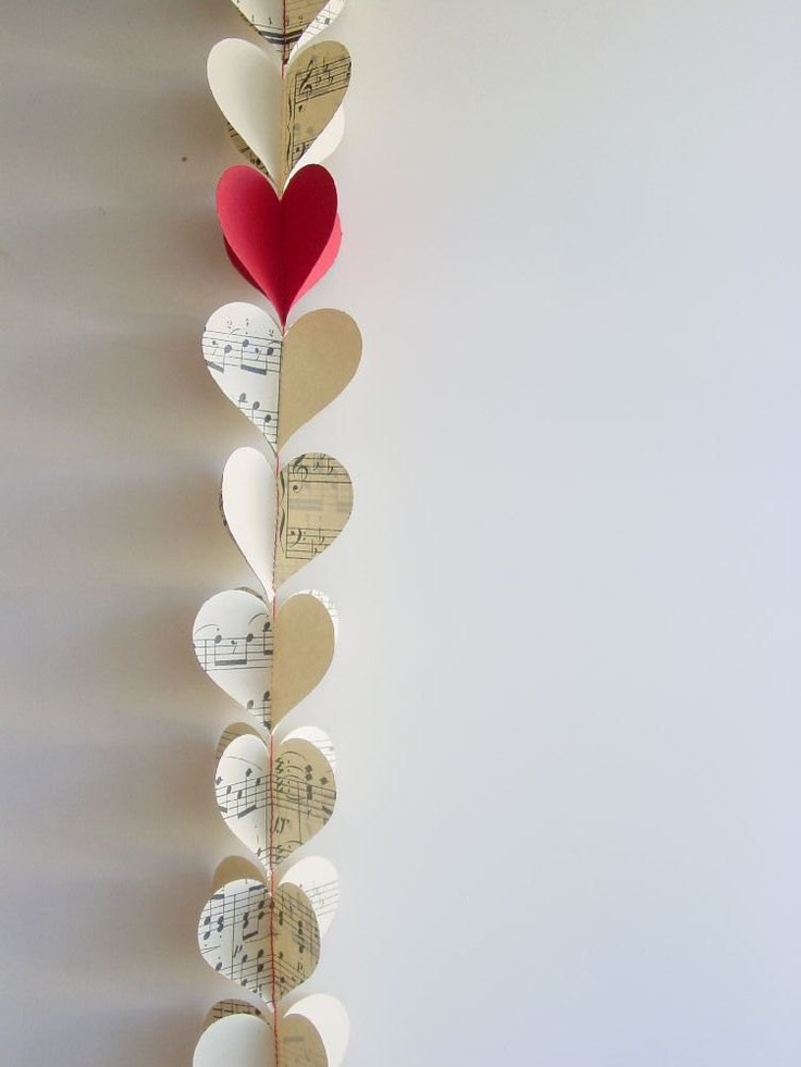 3DHeart Garland - Music Sheets & a Single Red Heart-Paper Mobile-Kids-Baby-Nursery Decor-Wedding-Valentine-Crib Mobile-Baby Shower Gift. $9.95, via Etsy.