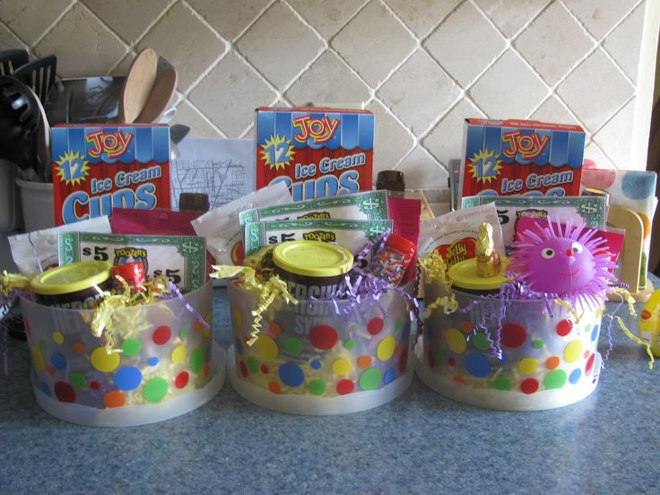 Cups Or Coffee Mugs Filled With Candy And Goodies For