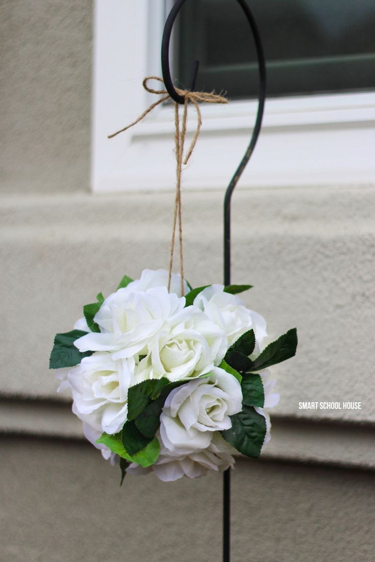 How to make hanging flower pomanders with wiffle balls in about 10 minutes!! Hang the roses around your home or use them for DIY wedding decor. Easy and stunning! These are also called flower kissing balls. You're never going to belive how quick and easy this DIY decor craft is.