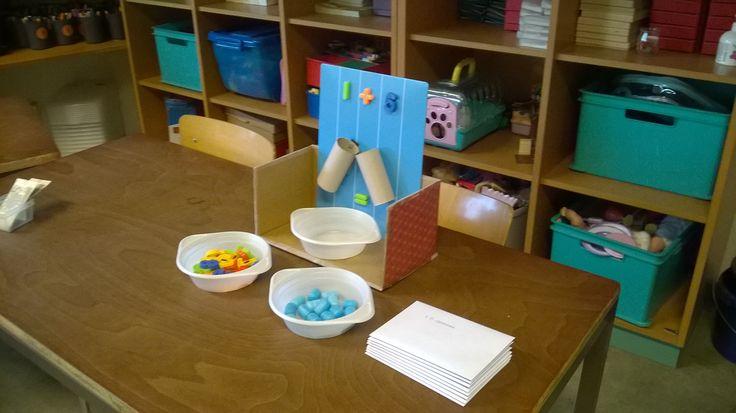 Optelmachine (inhoud: een magnetisch bord, magnetische getallen, 2 wc-rollen en 3 ronde borden)