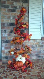 Turn a tomato cage upside down and decorate with garland, grapevines and pumpkins!