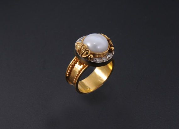 This luxurious, floral patterned, ring is entirely handmade in solid 22k gold . The natural gem in this design is a genuine Akoya cultered pearl