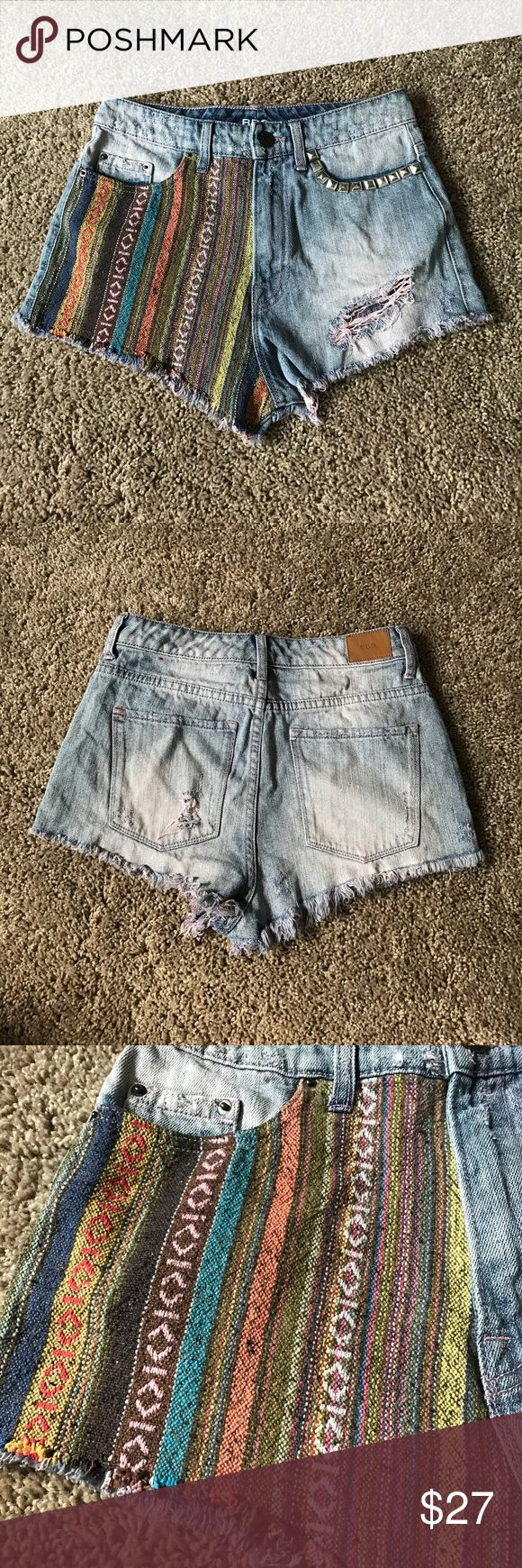 """UO BDG Embellished Distressed Shorts Urban Outfitters brand BDG """"high rise dree cheeky"""" pink tinted distressed denim shorts with studs and a patch of Aztec/tribal woven fabric. Super cute, in great condition. Size 26  100% cotton  Machine wash cold, line dry Urban Outfitters Shorts Jean Shorts"""