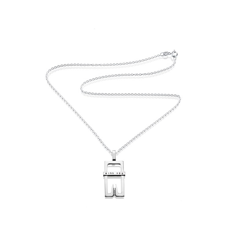 "Efva Attling - Miss You, Medium -   $205 - Silver pendant with the words ""Miss you"" engraved."