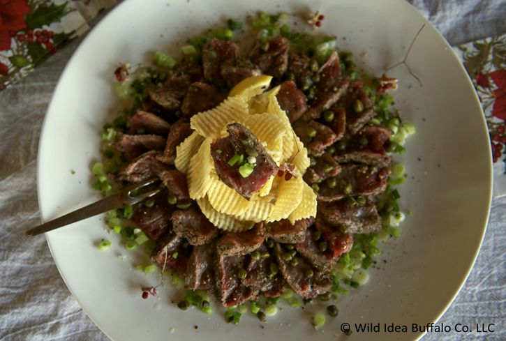 Wild Idea Buffalo Recipe of the Week - Bison Carpaccio. Bison Carpaccio *pronunciation: car-paht-cho Wild Idea Buffalo premium, 100% grass-fed bison steaks turns this very simple to make, tasty appetizer into a fabulous showstopper! My preparation may make a few chefs gasp, as I sear the meat while still partially frozen, but it works perfectly, especially for preparing ahead when entertaining.
