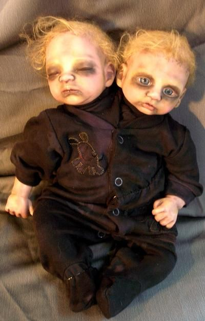 Broken doll??? No problem. Dress um up. Halloween's a coming ;) this would be so creepy in a chair or stroller on your front porch on Halloween.
