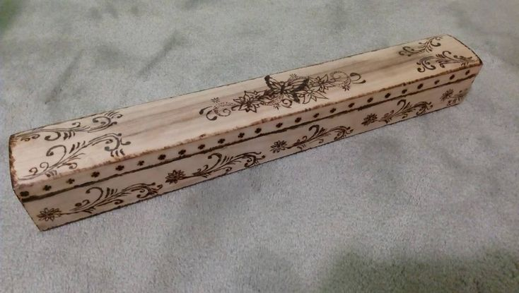 Wooden box decorated with pyrography