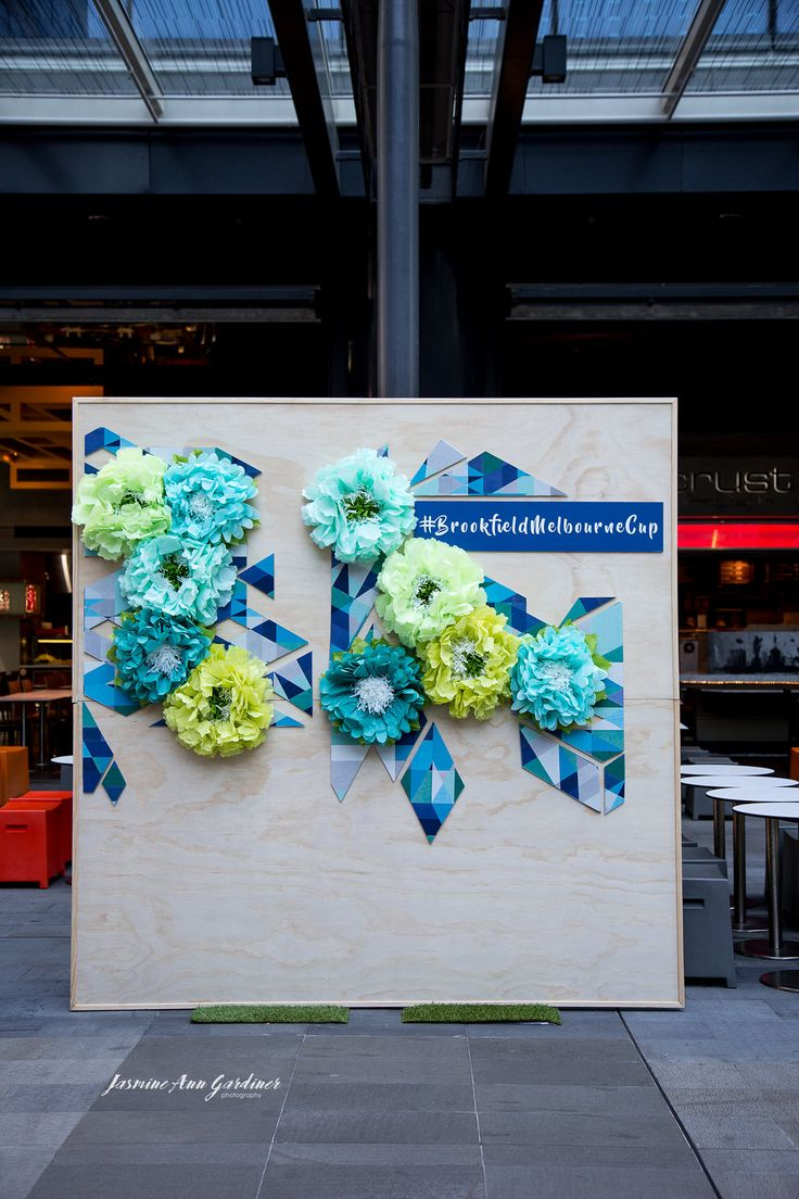 DY.o events (aka Duo)  Melbourne Cup Photo wall Paper floral installation on timber walls. Corporate event. Perth CBD.
