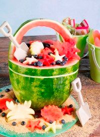Watermelon Beach Bucket. The crab and other critters are cut out using beach theme cookie cutters.