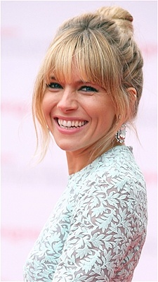 June 13 hairstyle of the day. Sienna Miller is sporting a messy bun as she attends a brittish tv awards gala. Love her dress and the lace. I am still making up my mind about the bun. Maybe it is too messy. She needs a more polished look.
