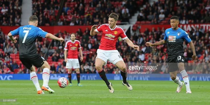 Michael Carrick of Manchester United in action with Marc Pugh and Joshua King of AFC Bournemouth during the Barclays Premier League match between Manchester United and AFC Bournemouth at Old Trafford on May 17, 2016 in Manchester, England.