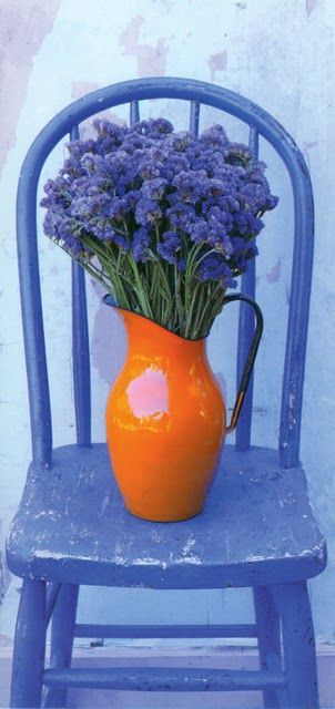 orange pitcher on periwinkle blue chair, love the photography, very inspiring