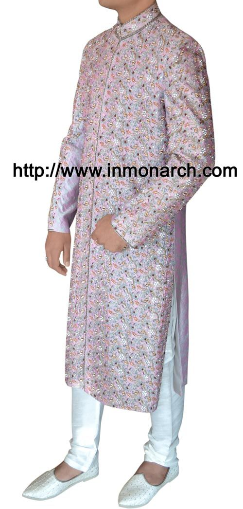 Ethnic stylish look designer work wedding sherwani made from lavender color brocade fabric. Hand embroidered as shown. It has bottom as chudidar made from dupion fabric in white color.