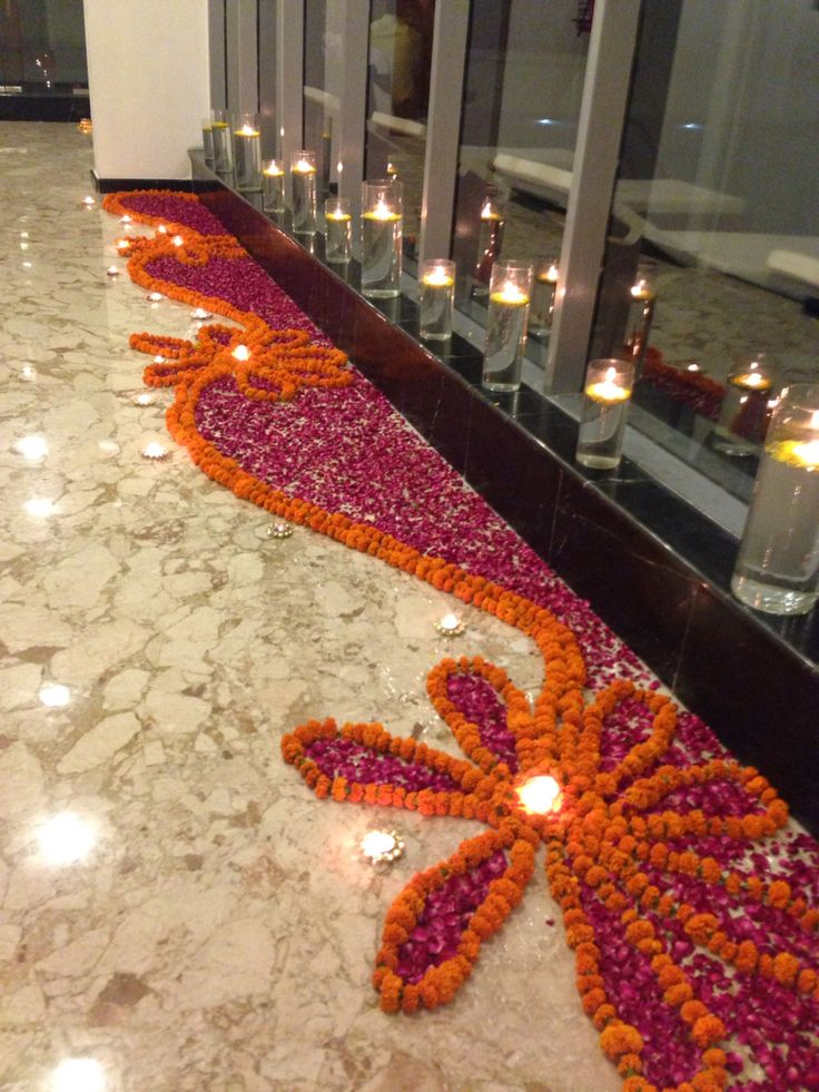 Charming Floral Rangoli For A Diwali Party With Crystal Tealights · Mandir DecorationGanpati  Decoration At HomeFlower DecorationJanamashtami Decoration IdeasIndian ...