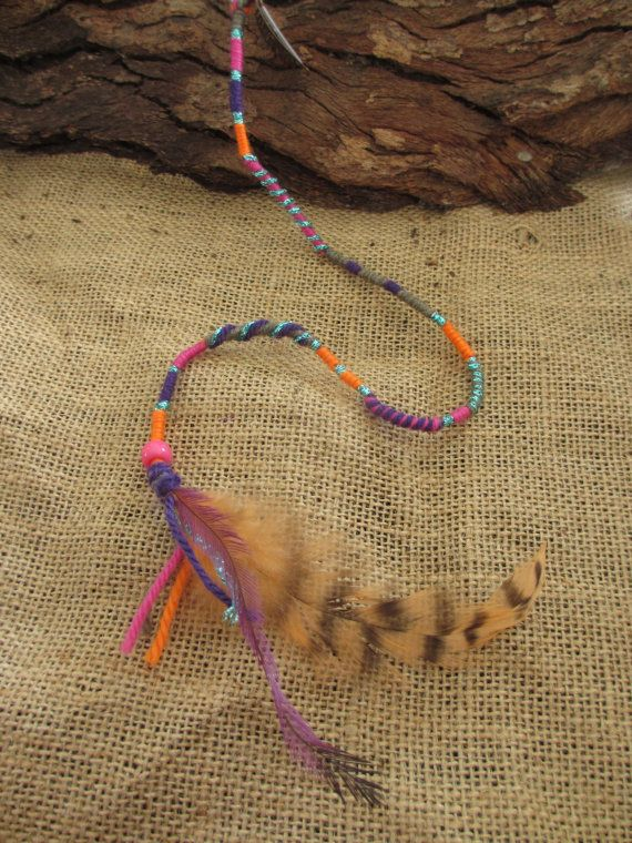 Colourful clip in feather hair wrap by NoodgeDesigns on Etsy, $20.00