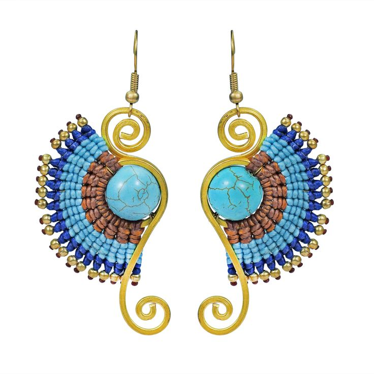Artisan Tor handcrafted this vibrant and stylish dangle earrings. This Macrame design features a turquoise centerpiece accented with brass swirls and beading. A casual chic earring set that is a perfect accessory to your style and natural beauty.