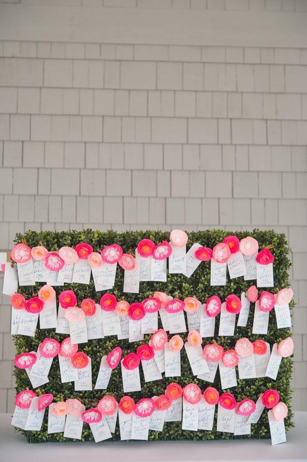 Pink paper flower and blue watercolor calligraphy escort cards. #weddingdetails #outdoorwedding #katespadewedding @iloveswmag