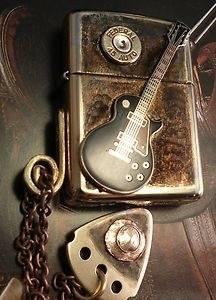 zippo guitar lighter with guitar pick bronze