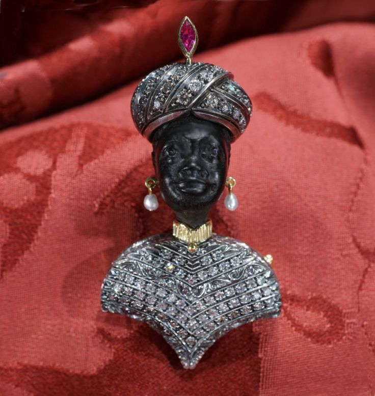 Moretto 50s Vintage Venetian Blackamoor period 1950 renovation year (head) 1999 18 kt yellow gold and silver 800, absolutely one of a kind, this moor mounts kt 1.60 of diamonds and small ruby on the turban, finely engraving, ebony – brooch and pendant. height dimension 5,2 cm max width 3.2 cm
