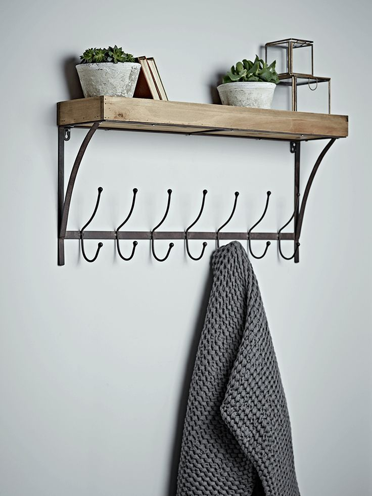 Crafted from solid fir wood with seven rust coloured iron hooks, our useful shelf unit will sit perfectly in your hallway or utility room. Use to hang coats, hats and scarves, and display decorative items on the handy shelf for an attractive finish.