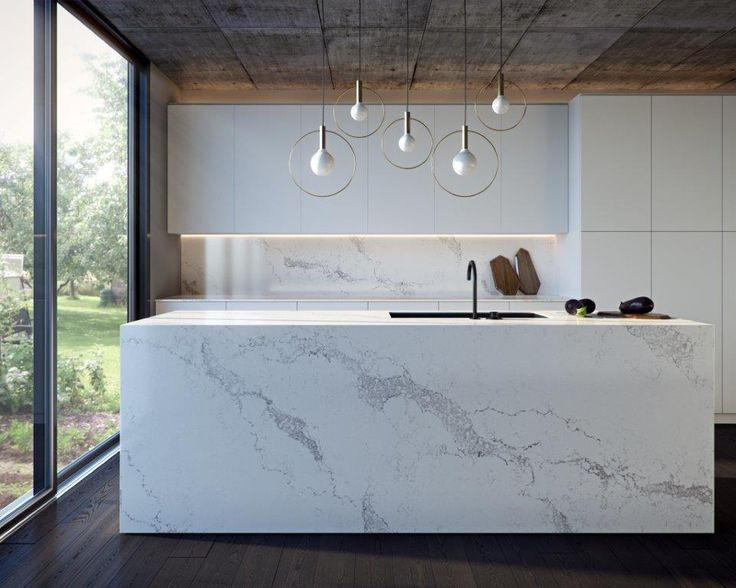 Caesarstone's new Statuario Maximus™ marble inspired design features broad warm grey veins sweeping across its soft white base colour, further enriched by delicate background veins.