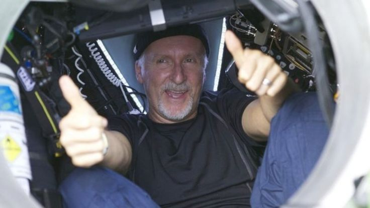 James Cameron back on surface after deepest ocean dive - BBC News