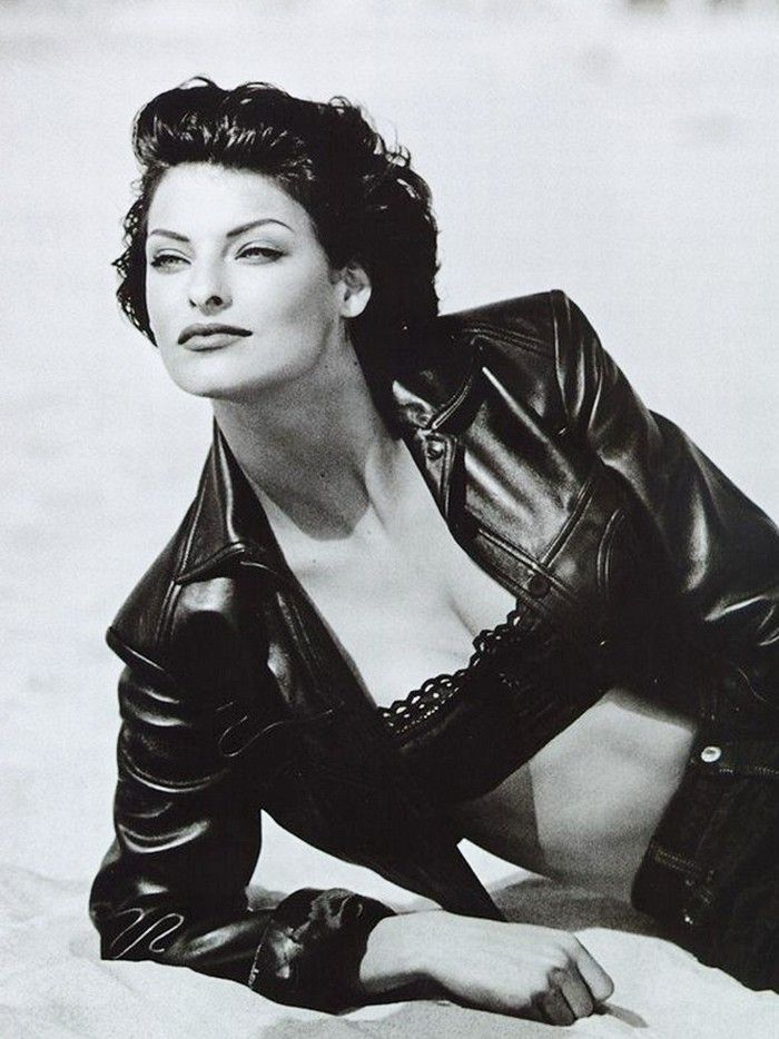 Linda Evangelista photographed by Peter Lindbergh for Vogue Paris, March 1992 wearing a leather jacket with a lace balconette bra