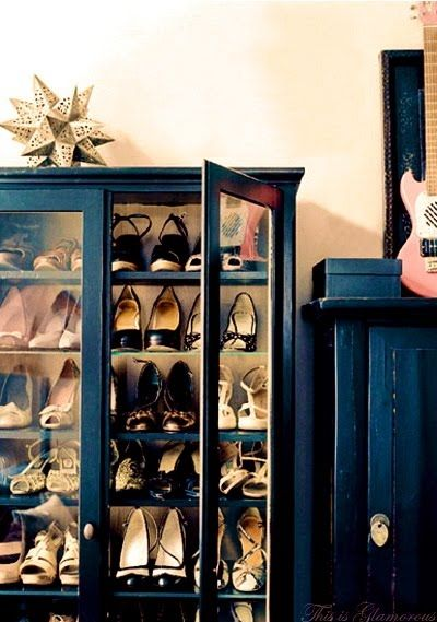 old bookshelf used to store/display shoes. @Karyn Beltle [you should do this]