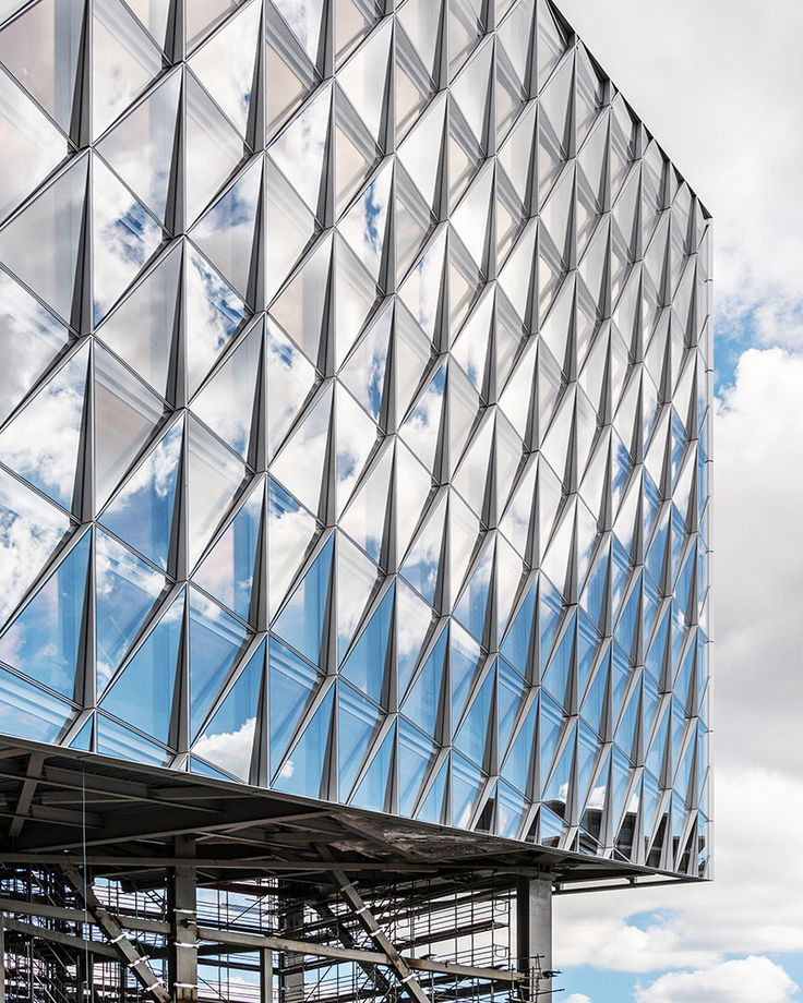 Reflecting NatureSited near Lake Geneva against the backdrop of the Alps, the JTI Building draws inspiration from the stunning natural beauty of its surroundings. The office building rises 51 meters at its highest point, with a glass facade designed to provide its occupants with inspiring views of the lake and mountains. The facade is composed of triangular glass panels—each 4.2 meters high by 3 meters wide—set at alternating angles across each face of the building. Viewed from the…