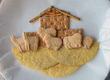 Edible Noah's Ark   Wax paper   2 hard taco shells   2 graham cracker squares   Animal crackers in pairs   3 pretzel sticks   Peanut butter or cake frosting   Plastic knife  Could actually use whole graham crackers for bottom instead of tortillas for a more realistic look.