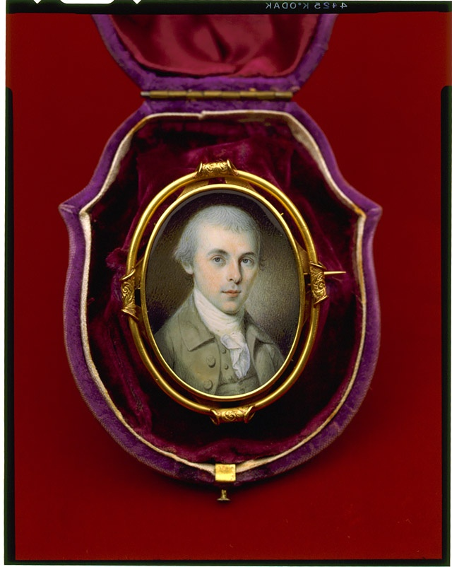 """[James Madison, bust portrait miniature, facing slightly right] Painting: watercolor on ivory, in gold case. creator: Charles Willson Peale, 1741-1827, artist. created/published [1783]. summary: Gold-cased oval portrait miniature, given to Catherine """"Kitty"""" Floyd, presented as a pin, in velvet-lined container. Item in Library of Congress Rare Book and Special Collections Division."""