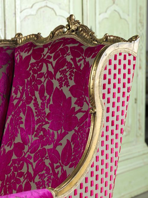 Great fabric duo. Gilded ornate wingback.