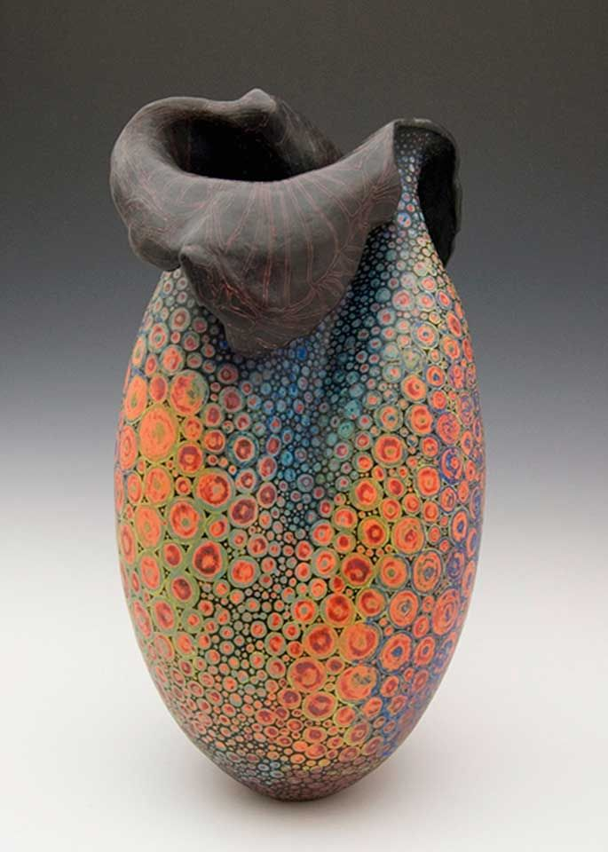 "Melanie Ferguson Ceramics, ""Coastal stones rolling ashore, crashing waves, eroding hillsides, the swirling ripple on water's surface, and the vibrant colors and rhythmic patterns of the ocean's flora and fauna provides me with endless intrigue and inspiration.  My hand-build earthen and stoneware vessels are influenced by this symbolic gesture of how energy moves in and around organic objects to reshape their form, bounce light and crush the old to cast anew."""