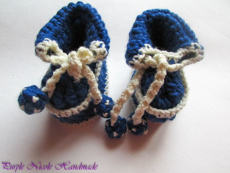 Craiova Maxima - Handmade Crochet Boys Bootees by Purple Nicole (Nicole Cea Mov). Materials: white and blue yarn.