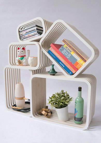 a multipurpose shelving set, of which the shape is customizable. the shelving system contains separate rectangular boxes in an open structure. the boxes are constructed in parallel, so they fit perfectly together. great fit in a modern home, and a timeless design piece, due to the variety of configurations. the pieces can be used individually, fitted together or even used as a room divider. the open structure shows, instead of hiding you precious items. #homedecor #furniture
