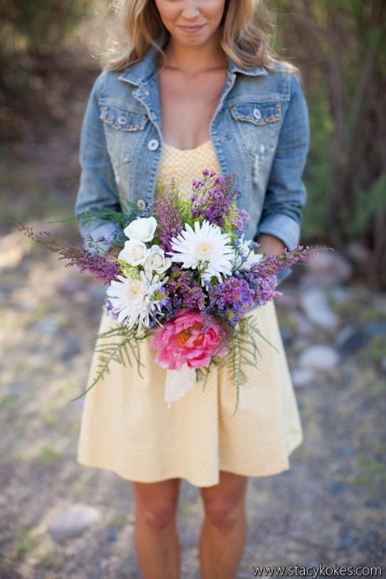 Keep it casual with a simple wild flower bouquet and denim jacket for your bridesmaids.