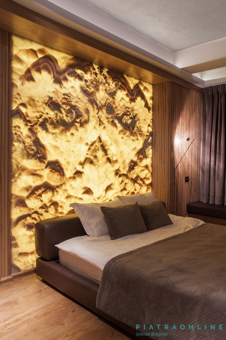 Master bedroom, urban modern design, elegant minimalism. Wall cladded with onyx slab. Apartment in Bucharest, Romania.