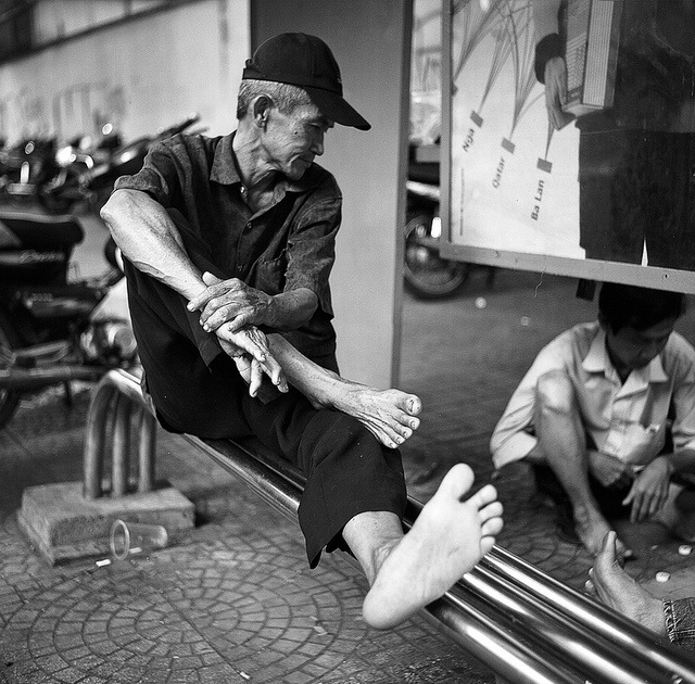 an old man in great position, taken with rolleiflex 3.5 MX-EVS