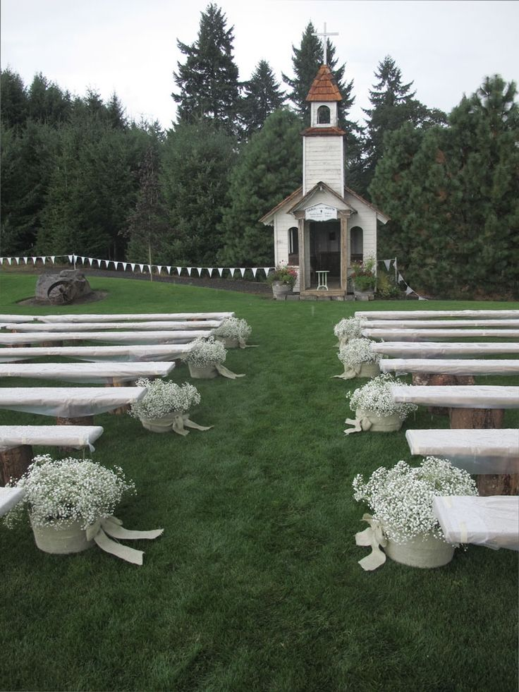 Roloff Farms wedding - baby's breath in metal buckets and burlap bows along aisle - Chickabloom Floral Studio