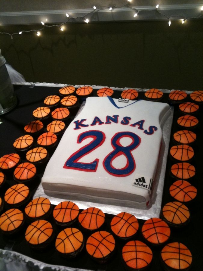 basketball cake | Chocolate cake with raspberry filling. Basketballs and jersey are ...