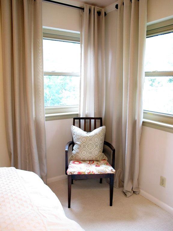 Benjamin Moore Ballet white wall paint, tan curtain panels, floral print chair, white bedding, cream carpet