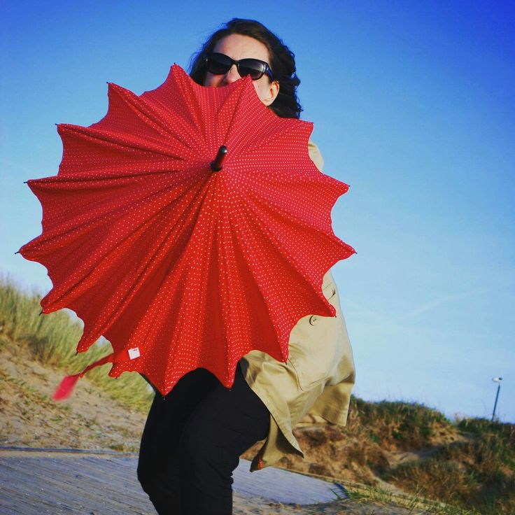 Red and teensy white polka dot brolly in vintage style, picture taken on the beach in St Anne's on the Sea, by Heartflower by the sea.
