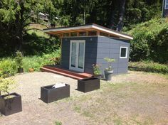 Modern-Shed 10' x 12' Coastal Cottage. Prefab shed kits delivered to your door. Visit www.outbuildings.ca