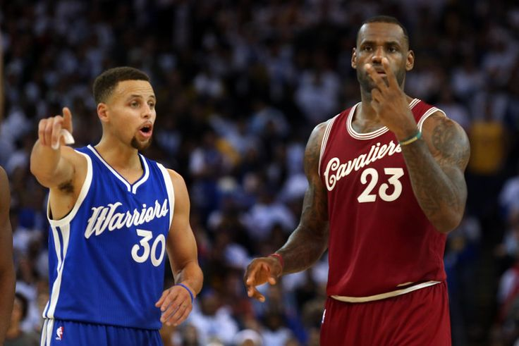 Golden State Warriors' Stephen Curry (30) and Cleveland Cavaliers' LeBron James (23) gesture in the second half of their NBA game at Oracle Arena in Oakland, Calif., on Friday, Dec. 25, 2015. (Ray Chavez/Bay Area News Group)