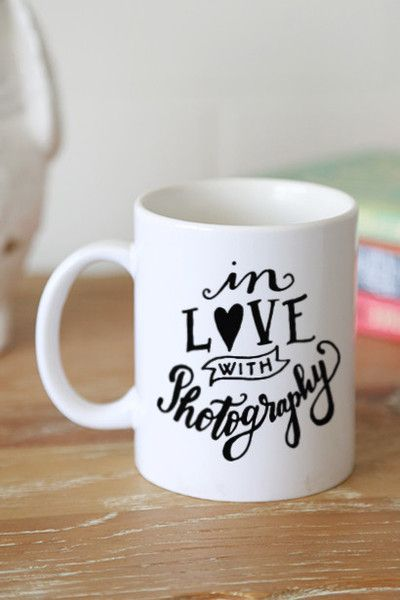"""When you no longer see Photography as a career/work but more as your true passion, then yes... you are officially in love with photography! Hand drawing mug quoting """"In Love with Photography"""". - Ceram"""
