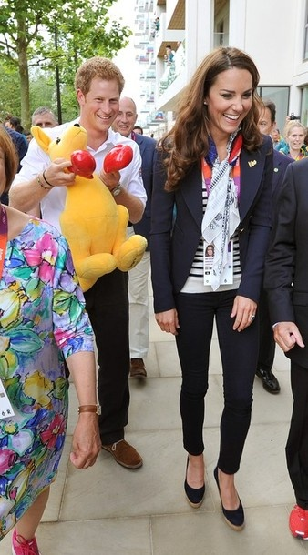 LONDON, ENGLAND - JULY 31:  Prince Harry holds a Kangaroo given to him by Australian athletes as he walks with Catherine, Duchess of Cambridge during a visit to the Team GB accommodation flats in the Athletes Village at the Olympic Park in Stratford on Day 4 of the London 2012 Olympic Games on July 31, 2012 in London, England.