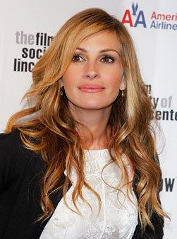 "Julia Roberts has gone blond before, but in my humble opinion, it never looked this good! So what changed? ""Julia's previous blonds have been cool and ashy and sometimes even looked frosted--a complete contrast to her warm skin tone and big brown eyes,"" says Doug Macintosh, colorist at John Sahag Workshop in New York City. ""The warmth of this honey blond better complements her natural coloring."" To get Julia's flattering hue, ask your colorist to give you a honey base with golden highlights…"