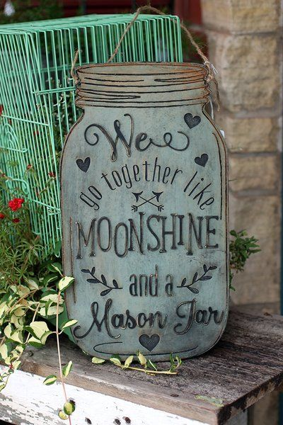 """We Go Together Like Moonshine and a Mason Jar Wood Sign. This sign comes in two sizes: 15"""" tall and 23"""" tall The jar is cut and engraved on 1/4"""" wood. Letters are cut out of 1/8"""" wood. They are hand painted, sanded, waxed and glued in place. The sign come ready to hang with twine."""