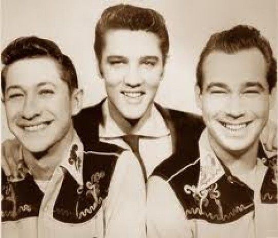 Scotty Moore, Elvis and Bill Black---------the trio that set the world alight