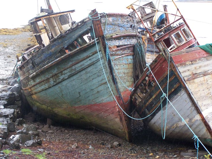Beautiful curves on these old boats rotting on a Scottish isle beach